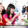 Girlfriends in cafe — Stock Photo #11673324