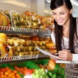 Woman in supermarket — Stock Photo #11673663