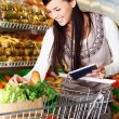 Buying goods in supermarket — Stock Photo #11673667