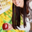 Woman with apple - Stockfoto