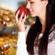 Smelling apple - Stock Photo