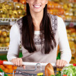 Female in supermarket — Stock Photo
