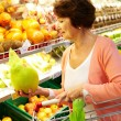 Woman in supermarket — Stock Photo #11673904
