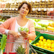 Woman with goods - Stock Photo