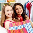 Stock Photo: Smiling shoppers