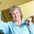 Exercise with barbells — Stock Photo #11674154
