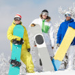 Stock Photo: Three snowboarders