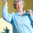 Womwith barbells — Stock Photo #11674520