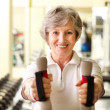 Stock Photo: Training with dumbbells