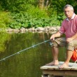 Senior fisherman — Stock Photo