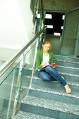 Student on stairs — Stock Photo