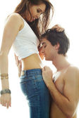 Portrait of young man face by his girlfriend's belly — Stock Photo