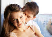 Close-up of young man kissing in woman's neck — Stock Photo