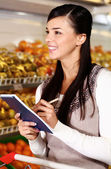 Shopper in supermarket — Stock Photo