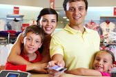 Family at shop — Stock Photo