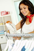 Shopper in clothing department — Stock Photo