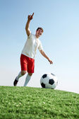 Footballer during play — Stock Photo