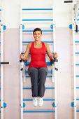 Girl on training machine — Stockfoto