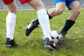 Kicking ball — Stock Photo