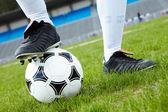 Foot on ball — Stock Photo
