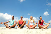Meditating friends — Stock Photo