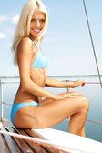 Girl on yacht — Stock Photo