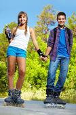 Couple on roller skates — Stock Photo