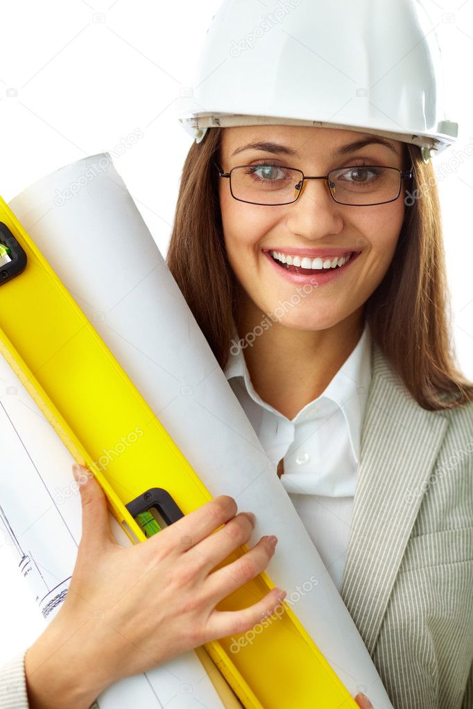 Portrait of smiling businesswoman in helmet holding rolled blueprints — Stock Photo #11670058