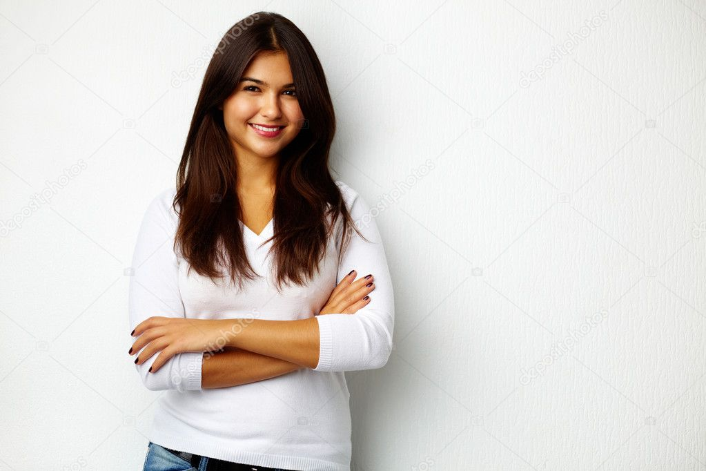 Portrait of pretty teenager standing by the wall — Stock Photo #11670316
