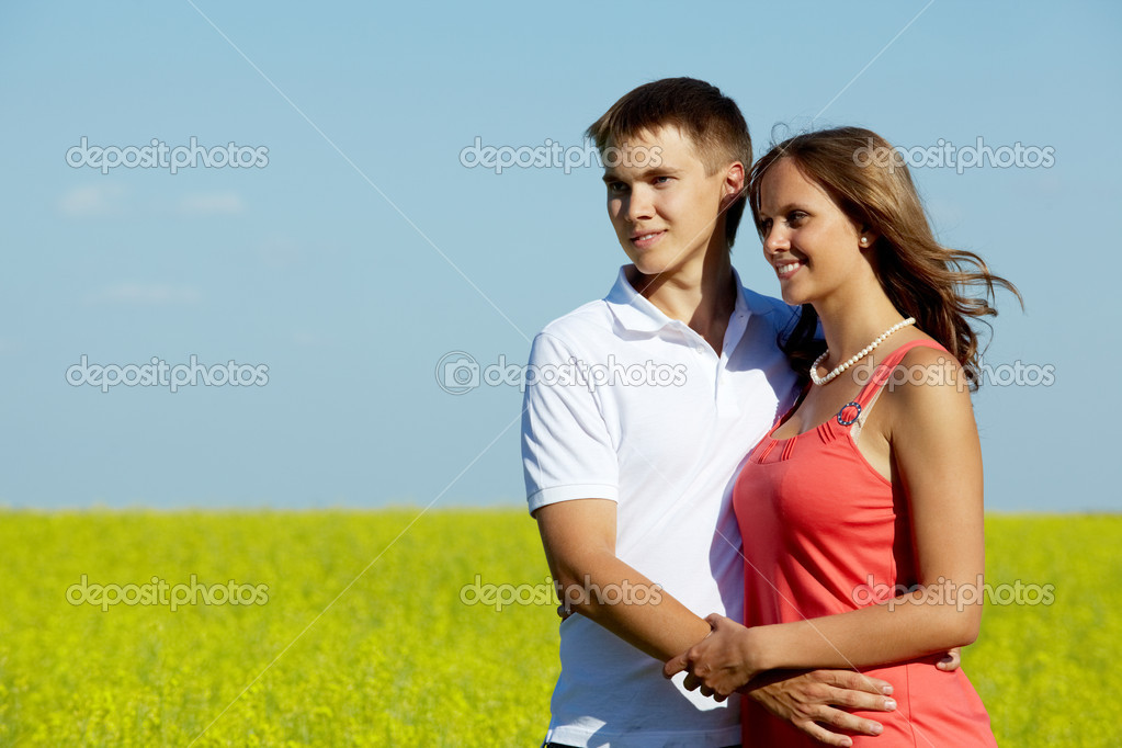 Image of happy couple in yellow meadow embracing — Stock Photo #11670765