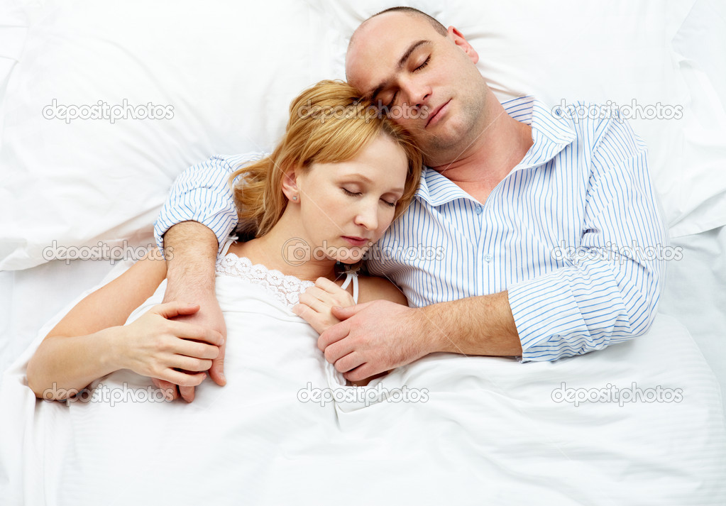 Photo of adult couple sleeping at night  Stock Photo #11671561