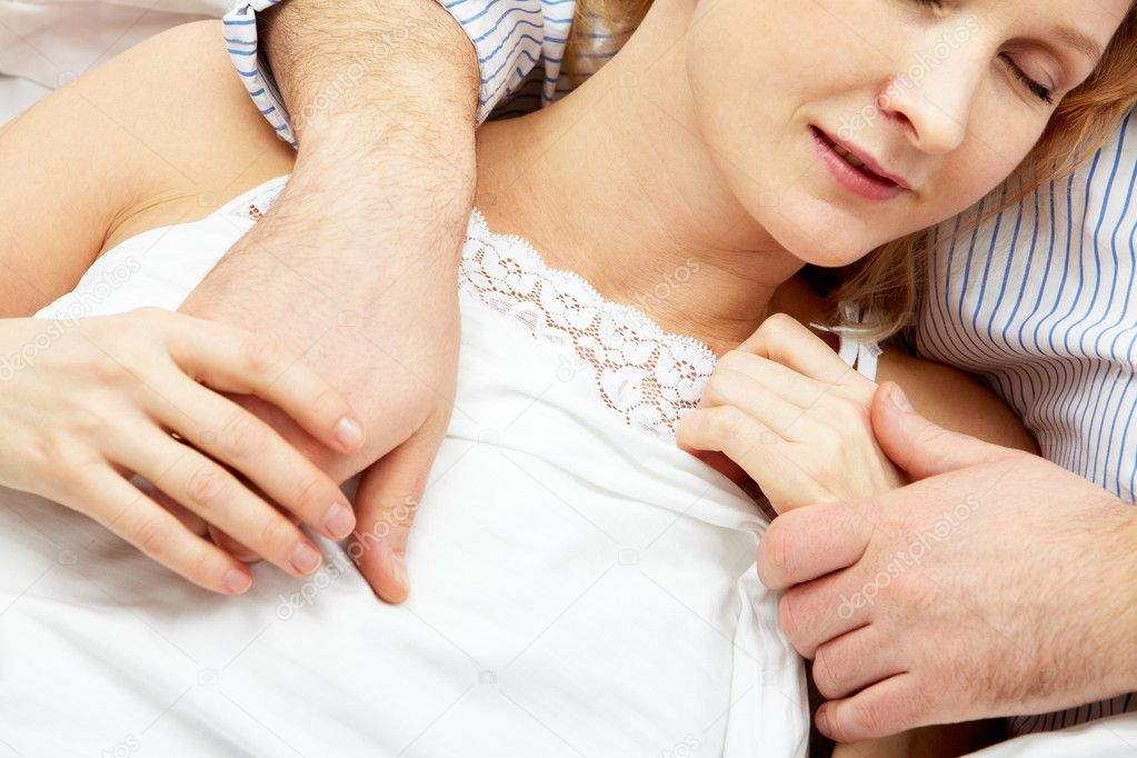 Close-up of woman sleeping in male hands — Stock Photo #11671565