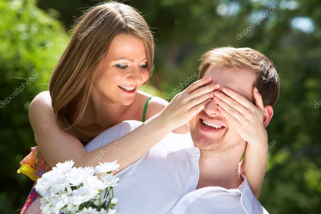 Photo of happy girl closing her boyfriend eyes by hands — Stock Photo #11671744