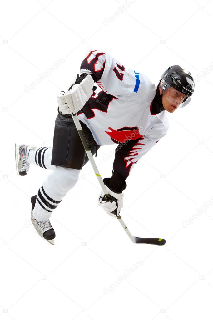 Portrait of hockey player playing in game — Stock Photo #11674269
