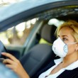 Driving in polluted zone - Stock Photo