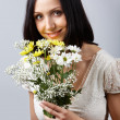 Brunette with flowers — Stock Photo #11692723
