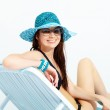 Smiling girl chaise lounge — Stock Photo
