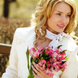 Stock Photo: Woman with bouquet