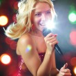 Pretty singer — Stock Photo