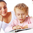 Reading with mother — Stock Photo