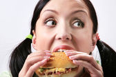 Eating hamburger — Stock Photo