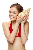 Girl with a seashell — Stock Photo