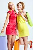 Gelukkig shoppers — Stockfoto