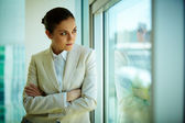 Woman by the window — Stock Photo