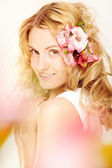 Flower-decorated hairstyle — Stock Photo