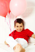 Lad with balloons — Stock Photo