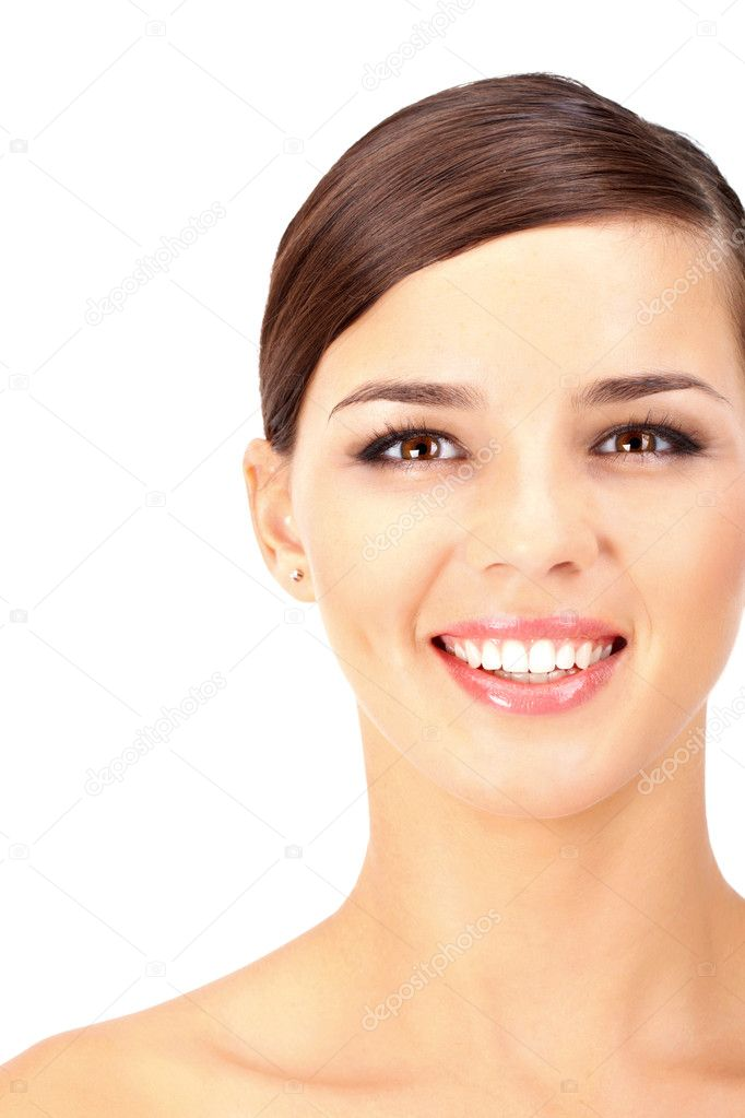 Portrait of a woman with make-up looking at camera and smiling  Stock Photo #11692329