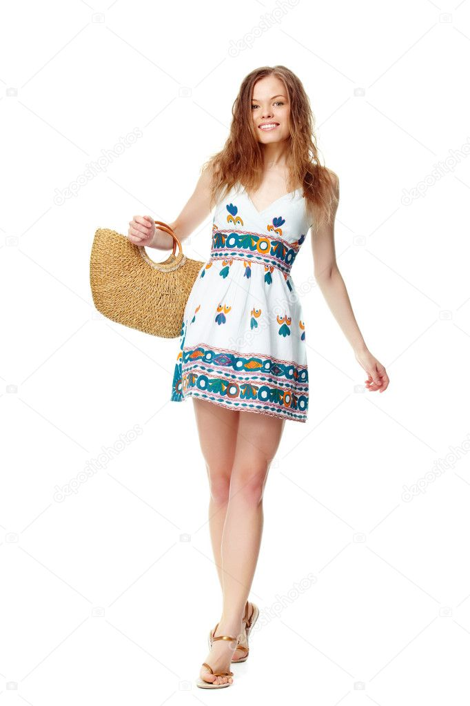 Portrait of a young girl in summer dress and with basket — Stock Photo #11692809