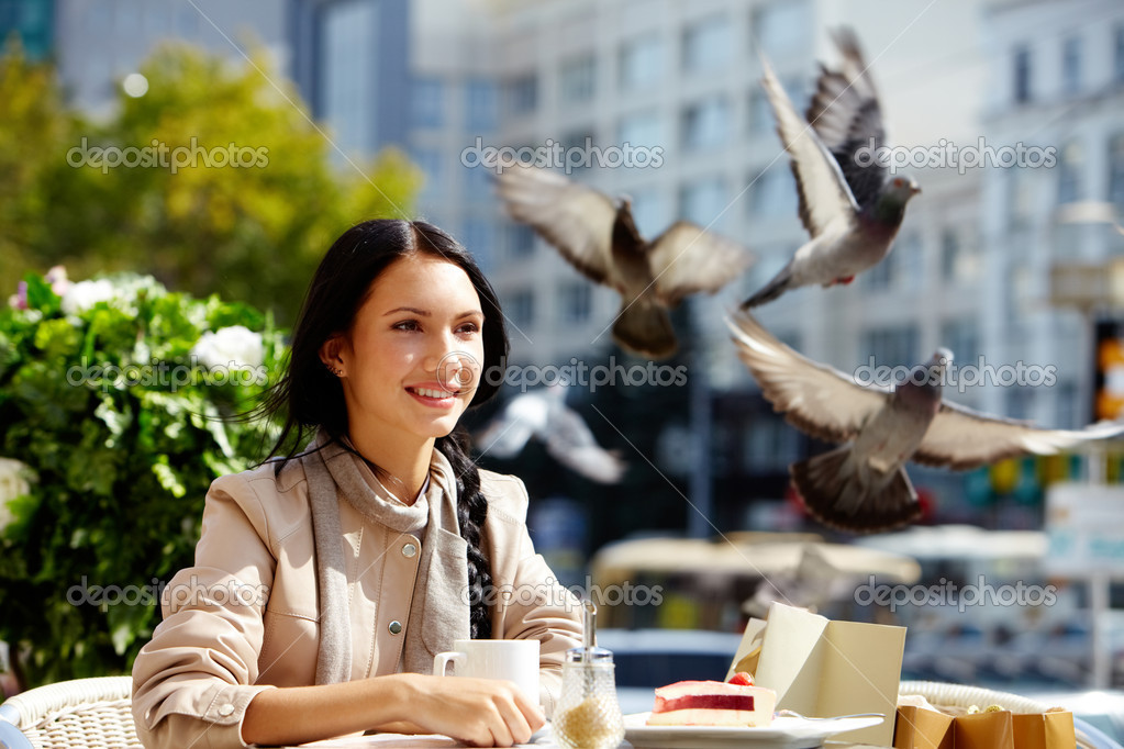 Image of happy female in open air cafe having coffee with cake in urban environment — Stockfoto #11693967
