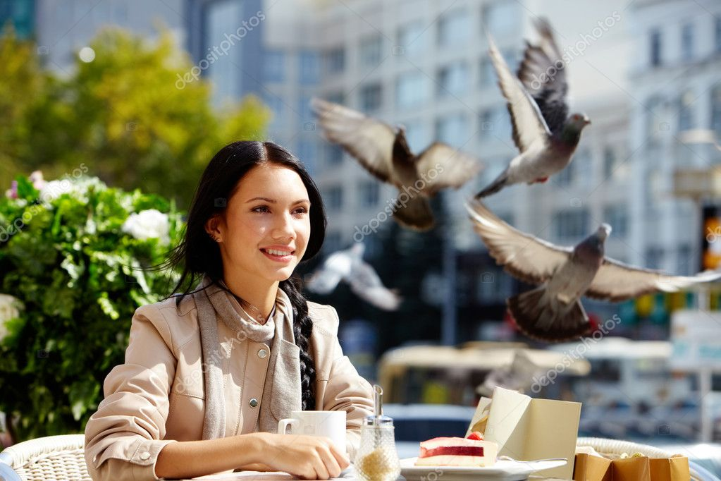 Image of happy female in open air cafe having coffee with cake in urban environment   #11693967